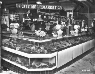 City Meat Market, stall #123 at the Crystal Palace Market. The market was owned by C.M. Wirges and T.J. Kenney and was also located at 314 So. 11th